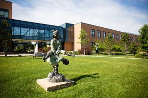statue of child playing on hospital lawn